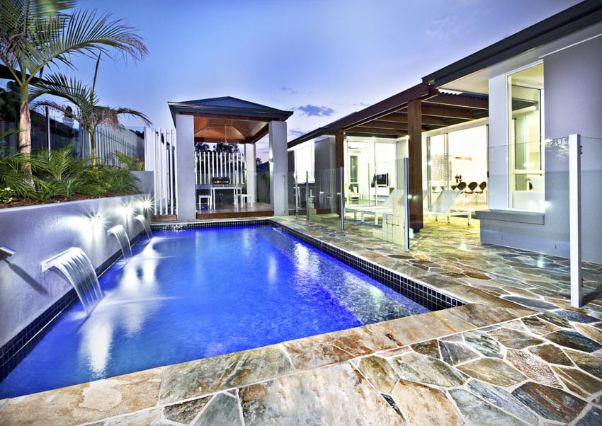 Modern Swimming Pool With Water Feature Fountains And Large Canopy