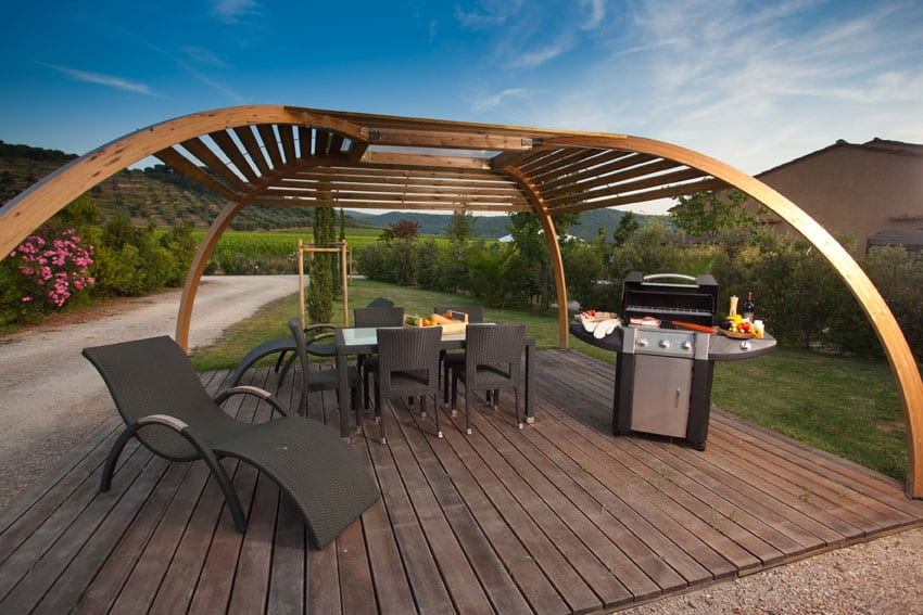 Modern Wood Pergola With Arched Frame Above Deck