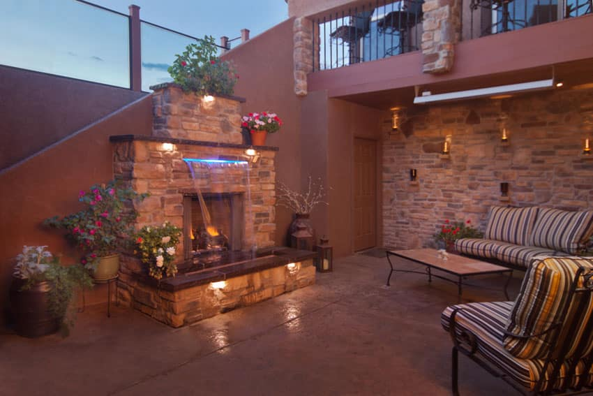 Sheetfall water feature in front of outdoor fireplace