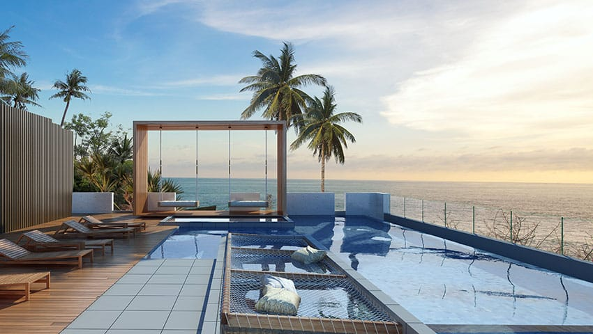 Tropical Swimming Pool With In Water Lounge Net Seating Palm Trees And  Ocean View