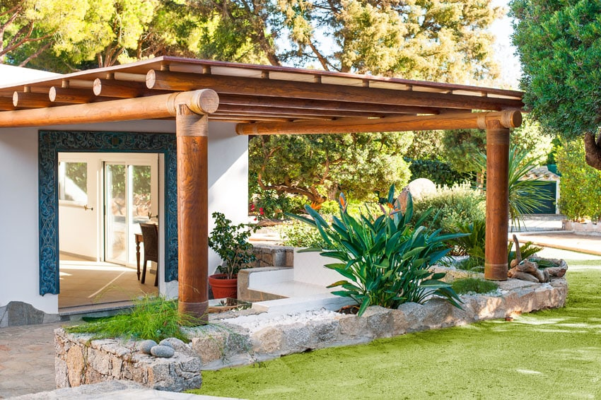 Wood pergola with large log beams and canopy