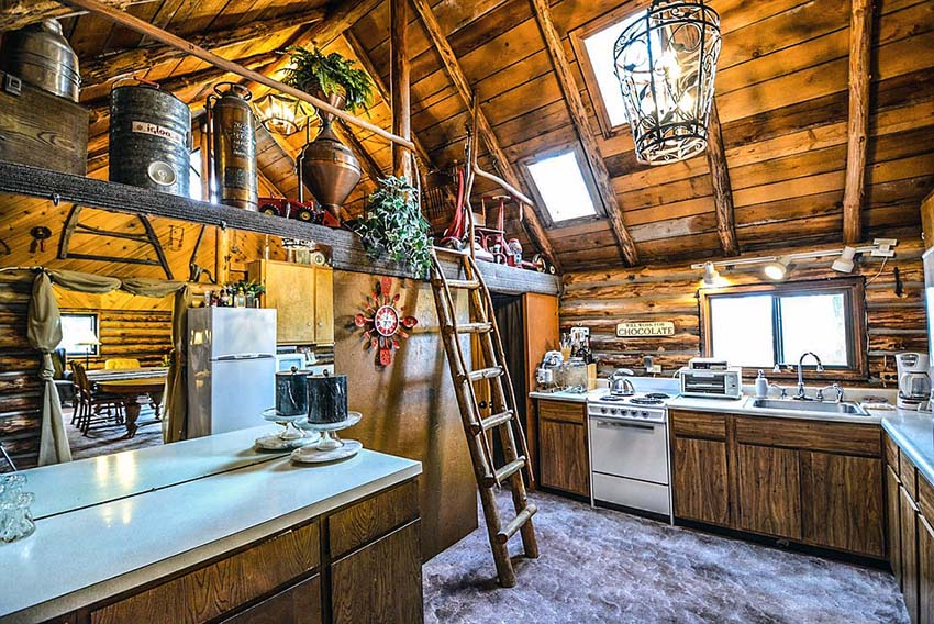 Rustic log cabin kitchen with ladder to loft