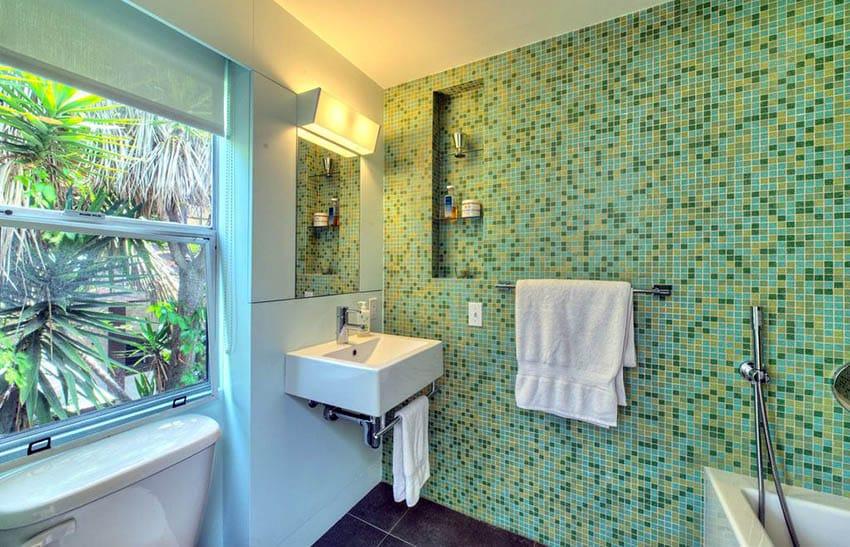 Bathroom with green mosaic tile wall
