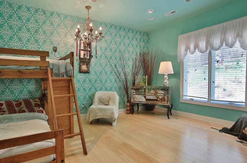 Bedroom with green pattern wallpaper and green painted accent wall