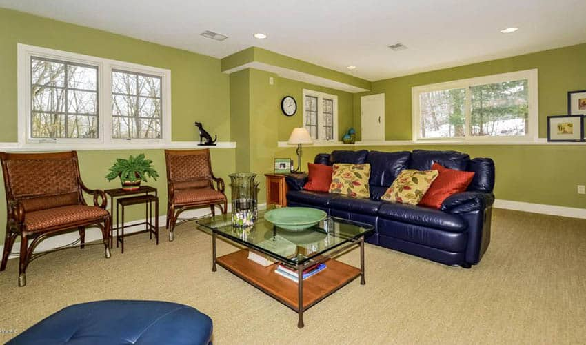 Bright green painted basement living room
