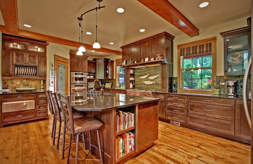 Craftsman kitchen with pine floors pendant lights and exposed beams