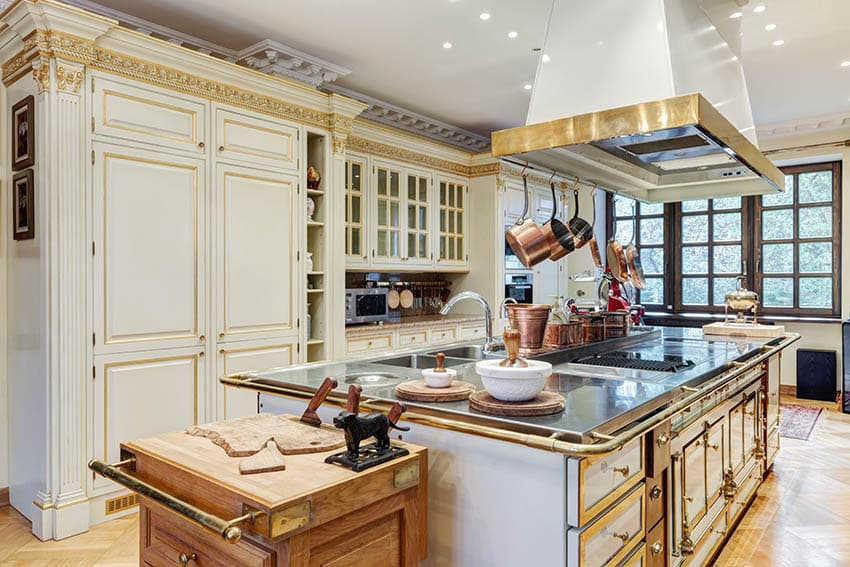 French provincial kitchen with cream mullion cabinets and gold trim