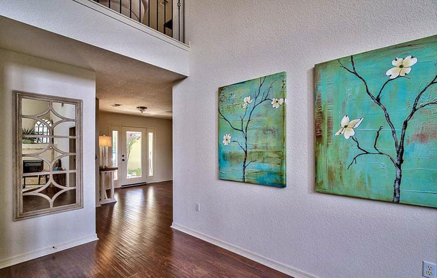 Hallway with bright green paintings artwork