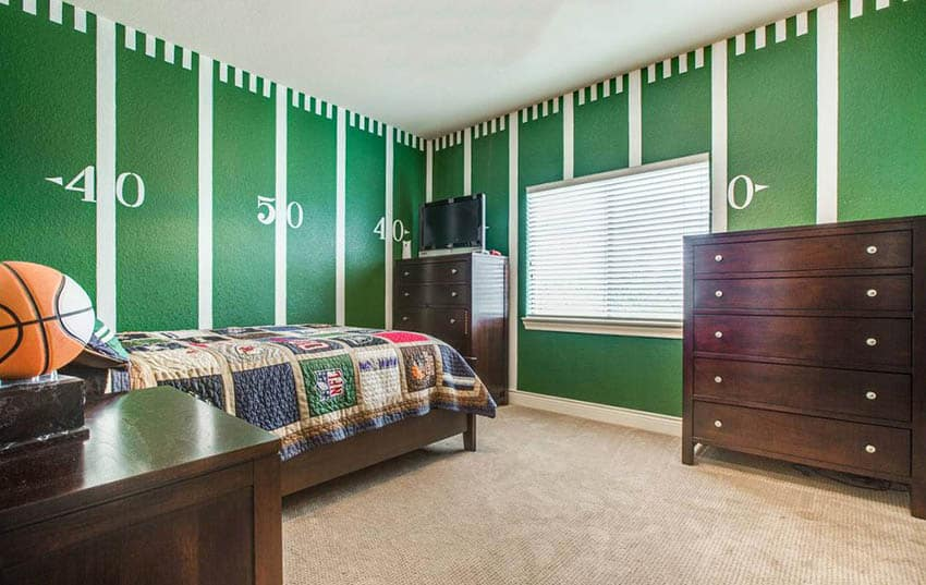 Kids bedroom with green football field painted wall