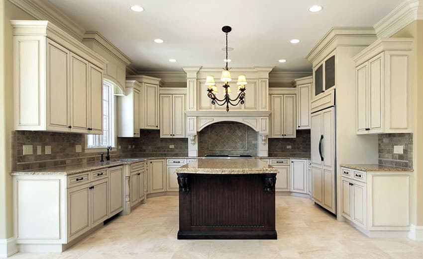 Kitchen with antique white heirloom finish cabinets