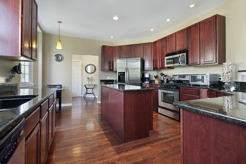 Kitchen with cherry stained and varnished wood cabinets