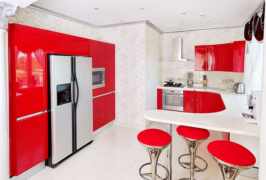Kitchen with red modular cabinets and peninsula