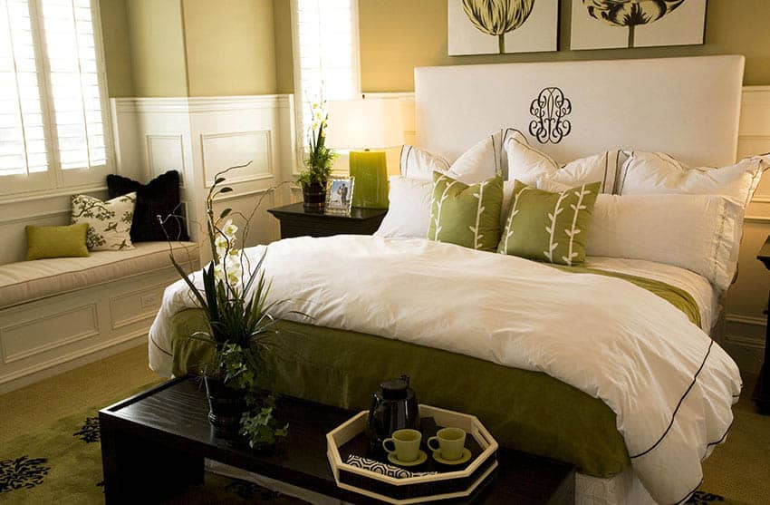Master bedroom with green painted walls and decor