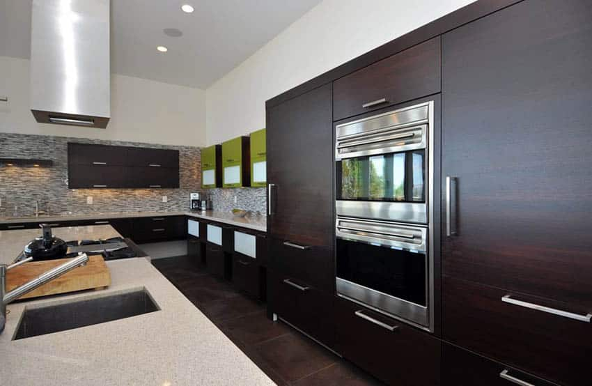 Modern kitchen with dark cabinets and iced white quartz countertops