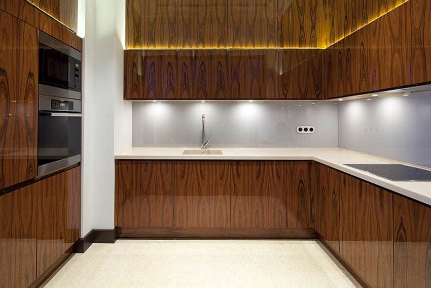 Modern kitchen with dark wood veneer cabinets and white countertops