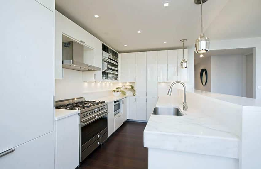 Modern kitchen with gloss white cabinets and calacatta marble countertops