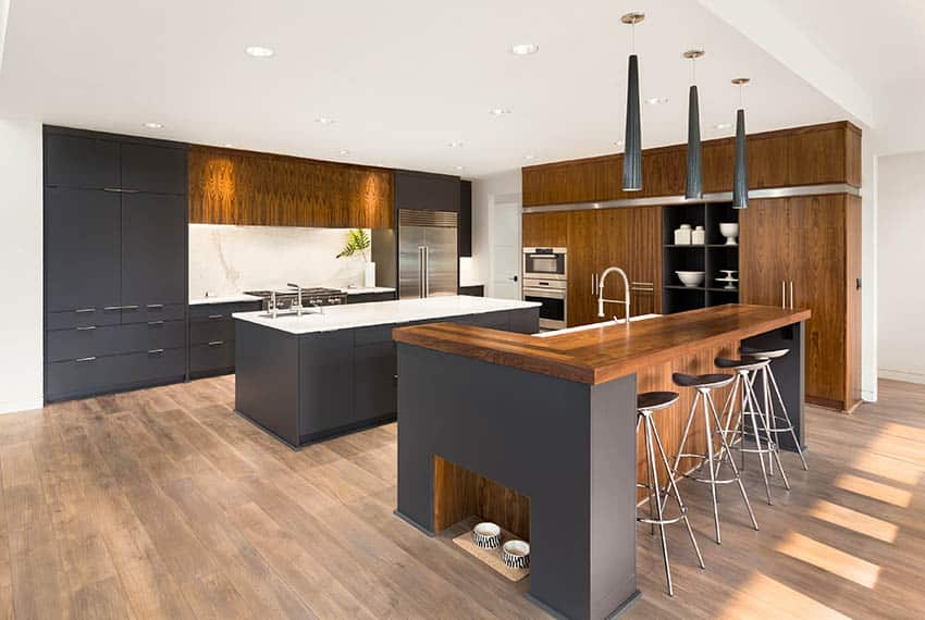 Modern kitchen with gray cabinets wood cabinets and two islands