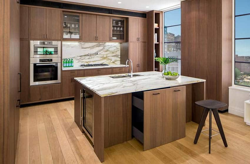 Modern kitchen with stained white oak cabinets marble countertop backsplash and wood floors