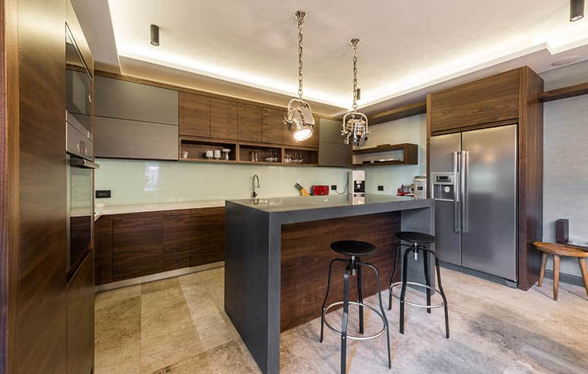 Modern kitchen with wood cabinets and gray island with pendant lights