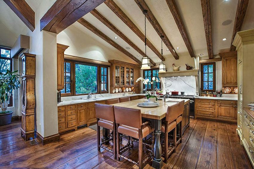 Rustic kitchen with raised panel cabinets and dining island with wood counter
