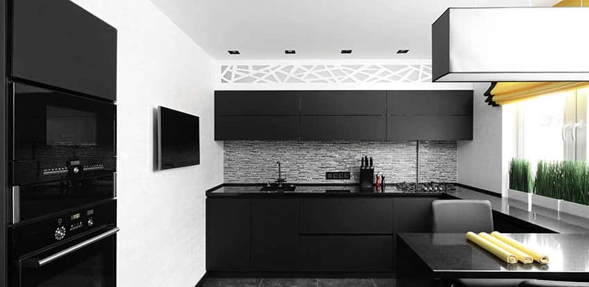 Small modern kitchen with j shape and black cabinets