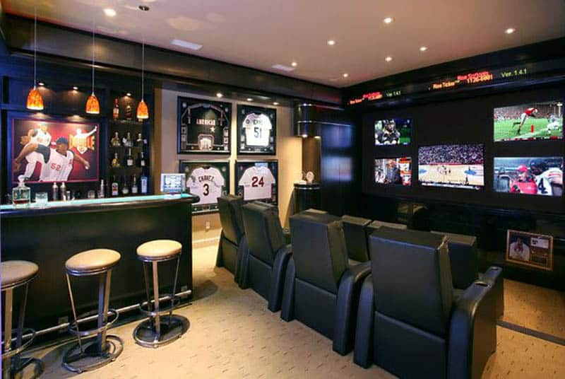 Black painted man cave with home bar and baseball theme