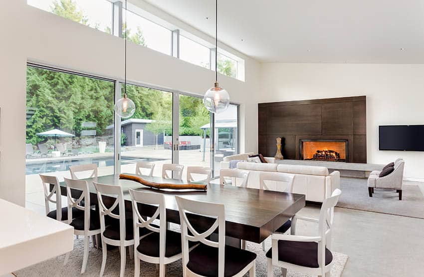 Contemporary dining room with glass globe lighting and natural light