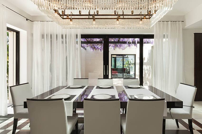 Contemporary dining room with large linear chandelier