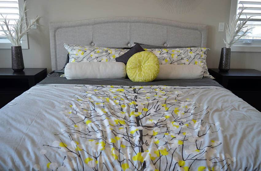 Gray bed with gray and yellow comforter