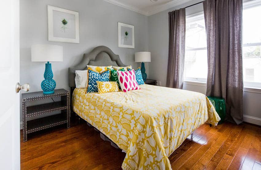 Light gray bedroom with gray bed and yellow comforter