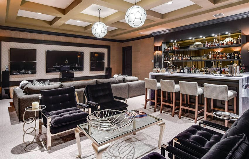 Living room with home bar with marble waterfall countertop and open shelving