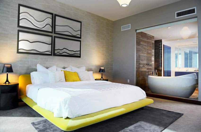 Modern bedroom with yellow platform bed and gray area rug