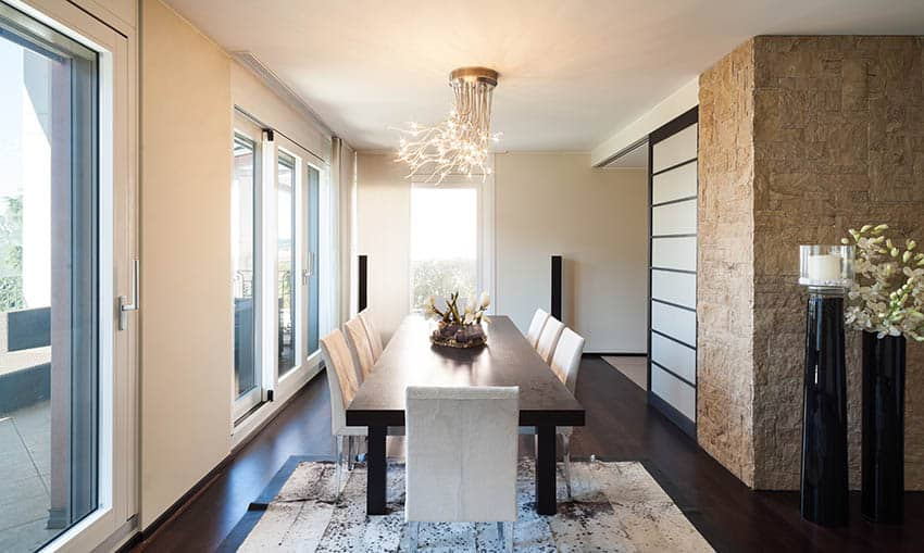 Modern dining room with semi flush light fixture with decorative prong design