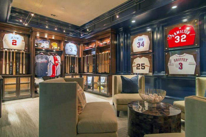 Navy painted man cave with sports team memorabilia