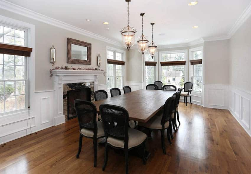 Traditional dining room with 3 light pendant fixture and rustic wood table