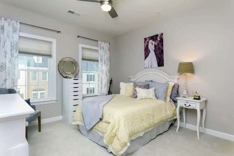Traditional gray bedroom with yellow comforter and pillows