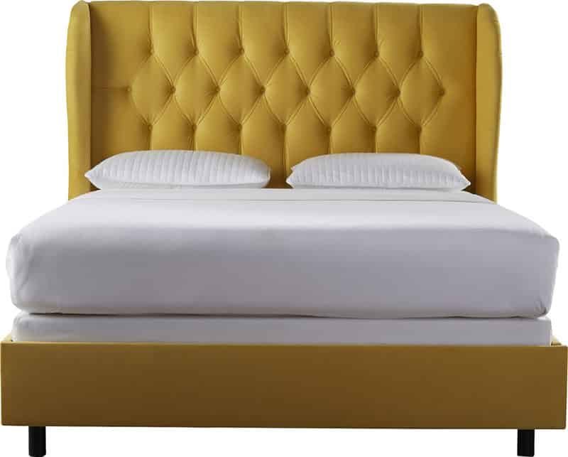 Yellow tufted upholstery bed