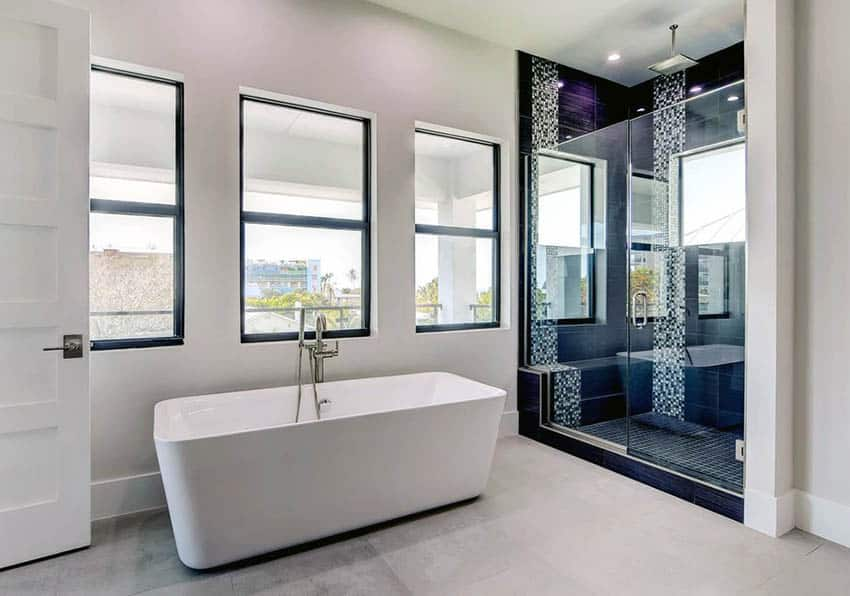 Contemporary bathroom with mosaic tile shower and freestanding tub