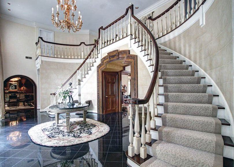 Foyer with staircase carpeting
