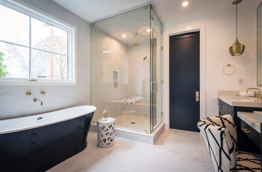 Master bathroom with cast iron tub glass corner shower and makeup vanity