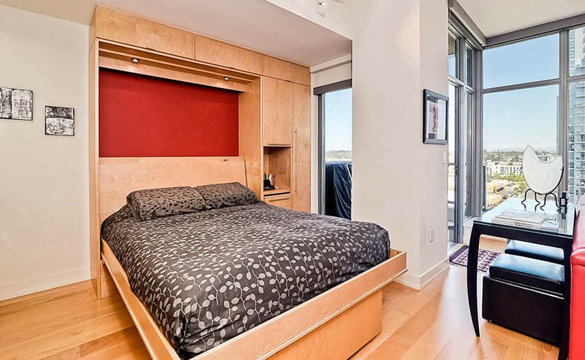 Modern bedroom with murphy bed with light wood cabinet