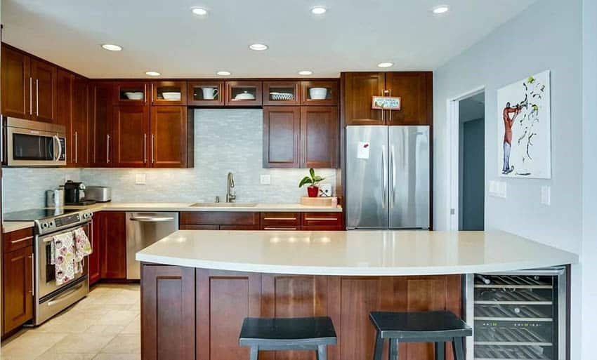 Contemporary kitchen with brown cabinets and windy blue paint color for walls