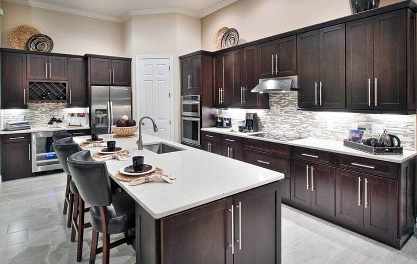 Contemporary kitchen with dark wood shaker style cabinets and ivory color paint