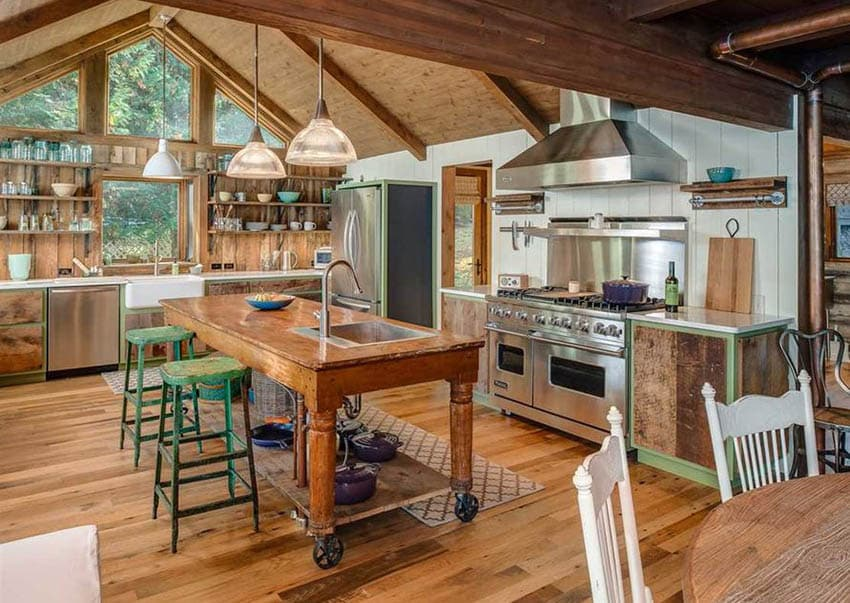 Country kitchen with wood cabinets muted green color paint