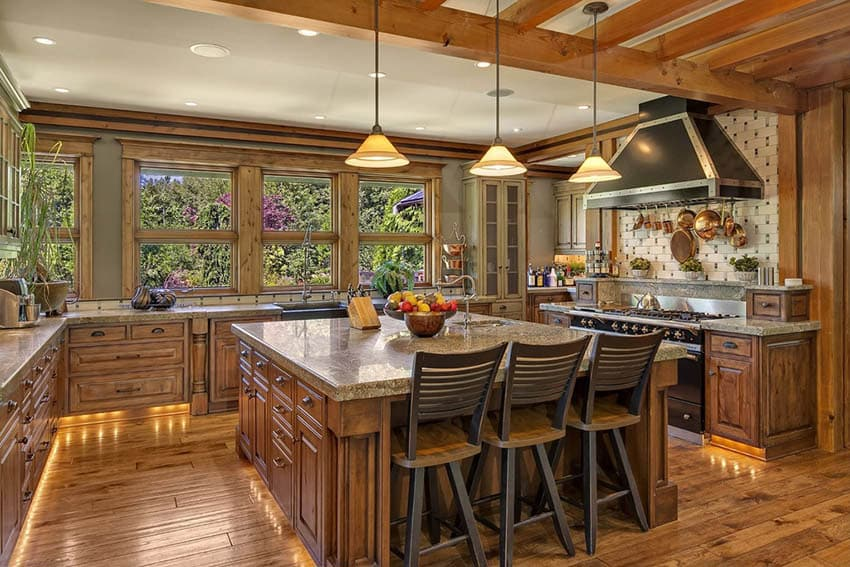 Craftsman kitchen with large island wood beams and olive green paint color
