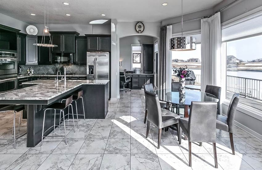 Dark cabinet transitional kitchen with gray painted walls and white marble tile floors