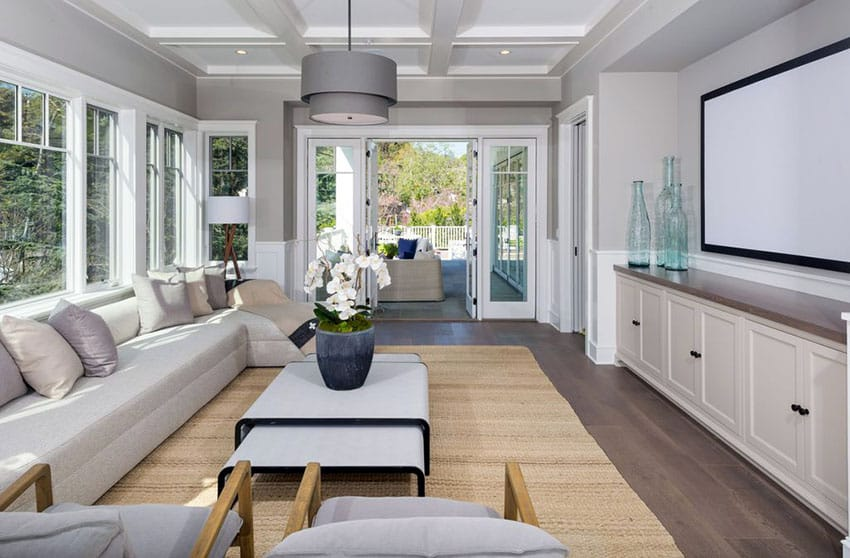 Gray living room with drum pendant light and french doors