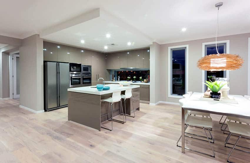 Kitchen with european style cabinets and greige paint color walls with light wood flooring