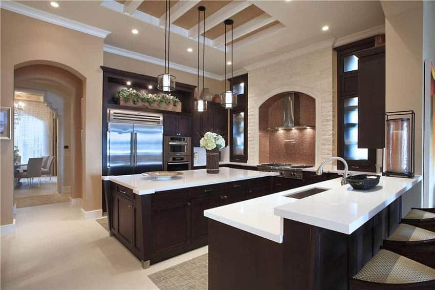 Large kitchen with dark cabinets two islands and mocha paint