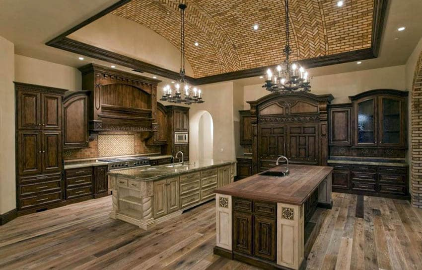 Luxury kitchen with brown cabinets and tan paint color walls with two islands